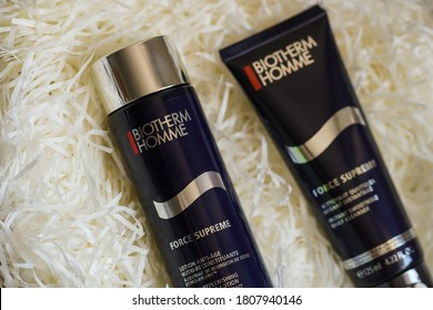 Shanghai / China - Feb 23, 2019:  Tube series of Biotherm Homme - Cleansing Gel, Eye serum and Tonic on gift package with copy space. For normal skin toning for men.