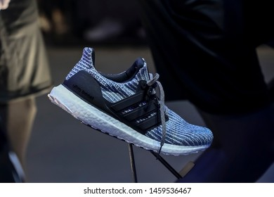 Shanghai, China, China, February 7th, 2019: At the Adidas counter in Shanghai, the salesperson exhibited a lot of new shoes for buyers to choose from.