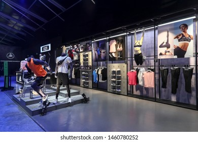 Shanghai, China, China, February 7th, 2019: Adidas' salesperson puts a lot of new products in the exhibition hall for buyers to buy and choose.