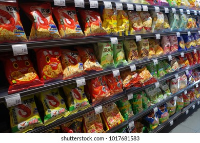 SHANGHAI, CHINA- JAN 22, 2018: Various brand of potato chips and snacks in packaging for sale on supermarket stand or shelf