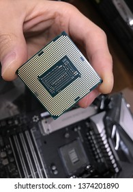 Shanghai, China - Jan 26, 2019: Closeup view of the back of an Intel Core i9-9900k. It's a high-end CPU for gaming and multi-thread productive tools. The capacitance and connector points are exposed.