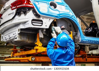 Shanghai, China, China - January 12, 2016: In the Shanghai Volkswagen factory, workers are assembling and producing the Volkswagen brand Santana sedan