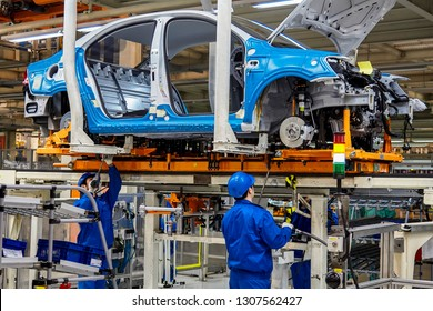 Shanghai, China, China - January 12, 2016: In the Shanghai Volkswagen production plant, workers are installing car chassis