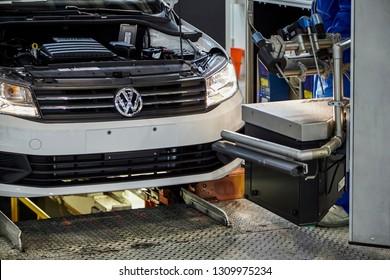 Shanghai, China, China - January 12, 2016: At the Shanghai Volkswagen manufacturing plant, workers are debugging the headlights of the Volkswagen Santana sedan