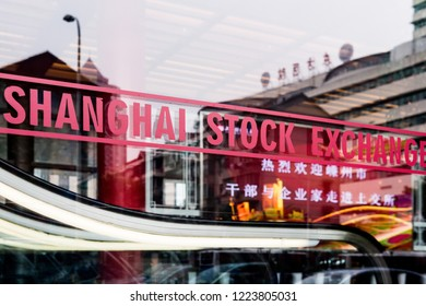 SHANGHAI, CHINA - January 2018: Shanghai stock exchange sign on glass window in China's most developed city