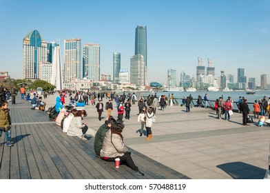SHANGHAI, CHINA - JANUARY 21, 2017: Tourist and Chinese people hanging out at the bund. The Bund is always busy, especially when it comes to weekend.