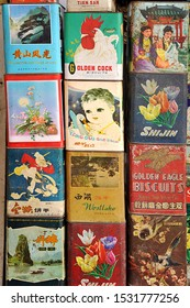 SHANGHAI, CHINA - JANUARY 28: Collection of old metallic vintage biscuits tin boxes for sale at the antique market, on January 28, 2010 in Shanghai, China