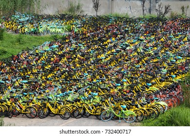 Shanghai, China - July 05 : Bikes sharing revolution economy booms in car park. Brands Ofo and Mobike. July 05 2017 in Shanghai, China.