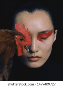 shanghai, china- july 20, 2019: Famous Chinese super model chunjie liu is on red eye shadow with A chicken head in her right eye, sexy and pretty Chinese woman