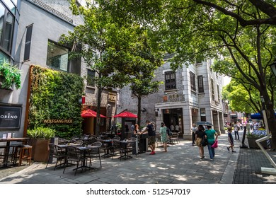 Shanghai, China - July 20th 2016 - Tourists and locals walking in the Xintiandi neighbourhood, a famous touristcs place in Shanghai in China