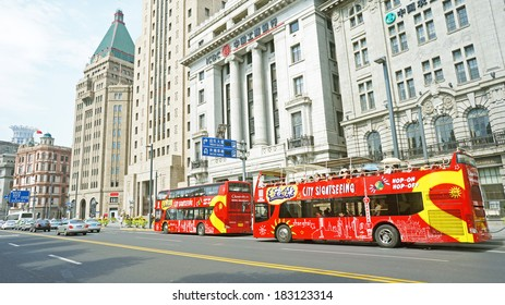 SHANGHAI, CHINA - JULY 21: Hop on Hop off sight seeing tour in Shanghai at the hangpu river on July 21, 2013 in Shanghai, The bund is the western bank of the Hangpu river facing pudong district.