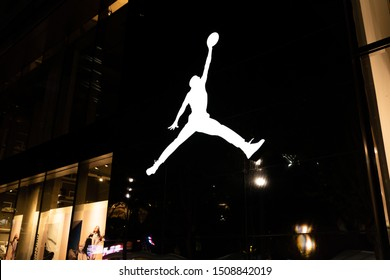 "Shanghai, China - July 28, 2019: Exterior of an Air Jordan storefront with its iconic ""Jumpman"" logo on the wall. The store is located on the ground floor of Raffles City Changning shopping mall."