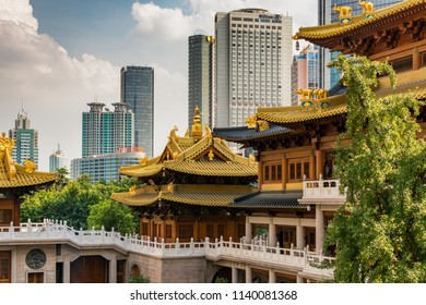 Shanghai / China - July 28th 2015: Historic Buddhist temple complex of Jing'an Temple on the West Nanjing Road in downtown area of Shanghai, China, surrounded by modern skyscrapers.