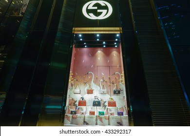 SHANGHAI, CHINA - Jun.8, 2016: Gucci store at night. Gucci is an Italian fashion and leather goods brand was founded by Guccio Gucci in Florence in 1921. Gucci has about 425 stores worldwide.