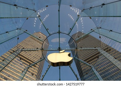 Shanghai, China - June 14, 2019: The Apple logo at an Apple flagship store in Shanghai's Pudong District.