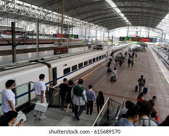 Shanghai China - June 2 2015. China Highspeed Rail station with bullet train at the platform boarding passengers.