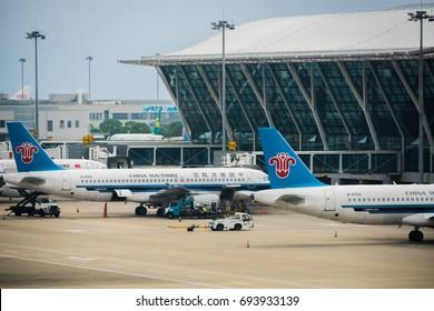 Shanghai, China - June 2016: China Southern Airlines aircrafts towed at Shanghai Pudong airport. China Southern Airlines is one of the biggest airlines in Asia based in China.