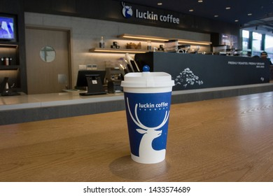 Shanghai, China - June 23, 2019: A Luckin Coffee cup on the table at a Luckin Coffee location in Shanghai's Minhang District. Luckin Coffee is a chain of coffee shops in China, founded in 2017.