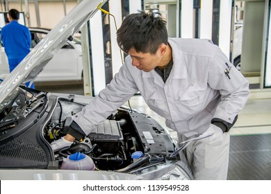 Shanghai, China, China - March 1, 2016: In the Shanghai Volkswagen factory, workers are checking the production of the Shanghai Volkswagen sedan