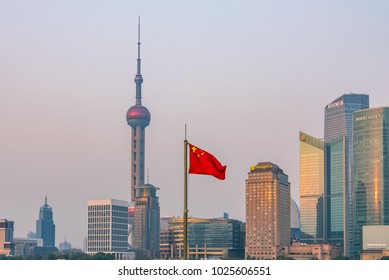 SHANGHAI, CHINA - MARCH 11: View of Pudong financial district architecture with Chinese flag on March 11, 2016 in Shanghai