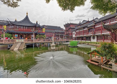 shanghai, China - March 16, 2018 - Tourists visiting the Yu Garden district, an ancient Chinese garden with traditional buildings in the Shanghai, China