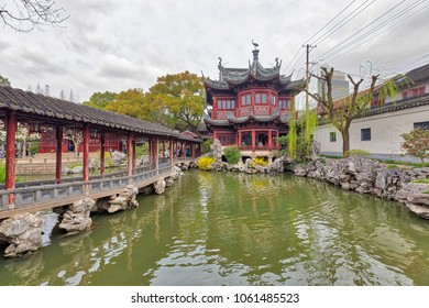 Shanghai, China - March 16, 2018 - Beautiful view of traditional Chinese pavilion, rockery and pond in Yu Garden, a famous Chinese ancient garden in Shanghai city, China.