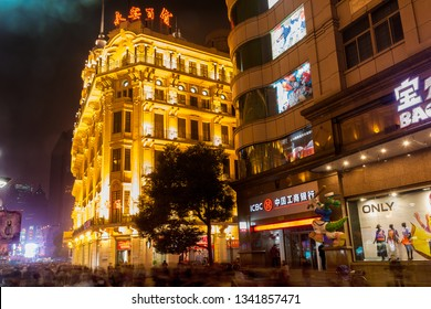 Shanghai, China - March 17, 2012: Busy night scene on the Nanjing Road. This street is the main commercial street of the city and one of the world's busiest shopping areas.