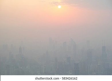 Shanghai, China - March  2, 2016: aerial view of the sunset in fog city.