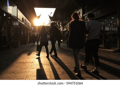 Shanghai, China - March 2, 2017: People walking at sunset in the City Temple of Shanghai