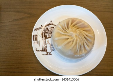 Shanghai, China, March, 2019. Delicious guan tang bao at Nanxiang Bun Shop, is a traditional Shanghai eatery located in the City God Temple precinct. It was established in 1900.