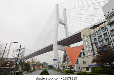 SHANGHAI, CHINA - MARCH 24: one of the most important bridges in Shanghai - Nanpu Bridge over Huangpu river on March 24, 2013 in Shanghai