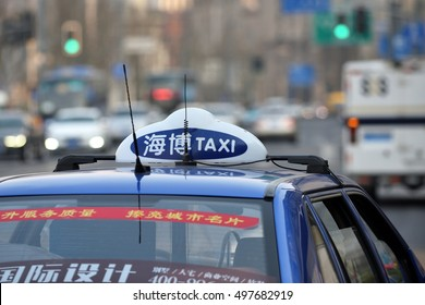 SHANGHAI, CHINA - MARCH 25: Taxi car on March 25, 2016 in Shanghai, China. Shanghai is the largest Chinese city by population.