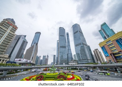 Shanghai, China, March 27, 2017: Oriental pearl tower near the high-rises and traffic