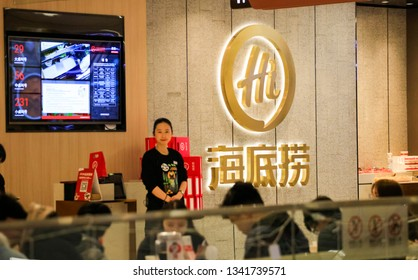 Shanghai, China - March 8, 2019: Clerk and LOGO of Haidilao Hotpot Store, a well-known catering enterprise in China. In 2018, Haidilao International Holdings was listed on the Hong Kong Stock Exchange