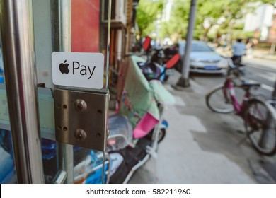 SHANGHAI, CHINA - MAY 04, 2016: Apple pay logo on small shop in Shanghai