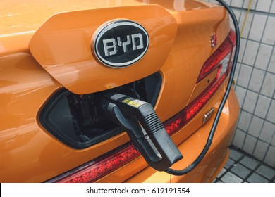 SHANGHAI, CHINA - MAY 05, 2016: Charging BYD electric car on street