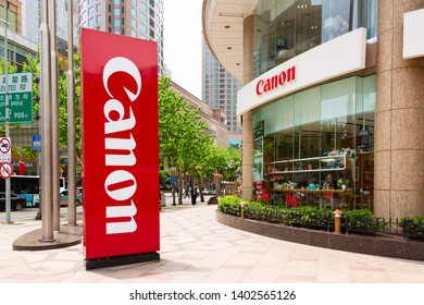 Shanghai, China - May, 2019: Canon logotype sign board at the entrance to the Canon shop in Shanghai, China