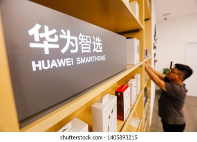 Shanghai, China - May 22, 2019: staff operate huawei computers at the huawei customer service center. Huawei is the world's leading provider of information and communications technology (ICT) solution