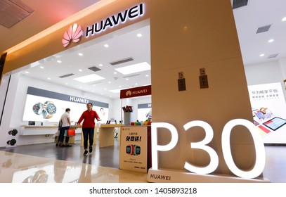 Shanghai, China - May 22, 2019: Huawei digital electronics and China mobile jointly operate the smart phone terminal sales stores.