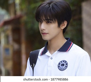 shanghai, china- May 25, 2020: Chinese actor Song weilong wears white high school uniform posing in campus