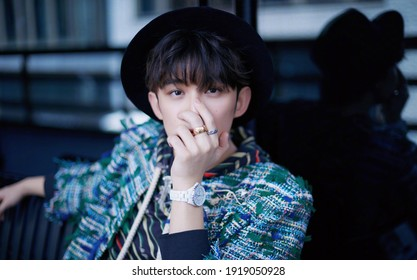 shanghai, china- May 25, 2020: Chinese famous actor Wu lei wears blue coat posing