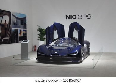 Shanghai/ China - May 26 2019: front view of a dark blue Nio EP9 super car on display with gull wing doors open at the Shanghai Super Classic car show