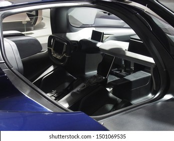 Shanghai/ China - May 26 2019: View of the interior of a dark blue Nio EP9 super car taken through the open gull wing doors at the Shanghai Super Classic car show