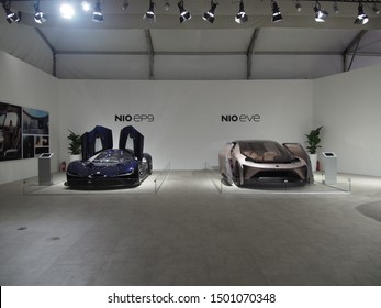 Shanghai/ China - May 26 2019: dark blue Nio EP9 super car with gull wing doors open and pale pink Nio Eve concept car with sliding doors on display at the Shanghai Super Classic car show