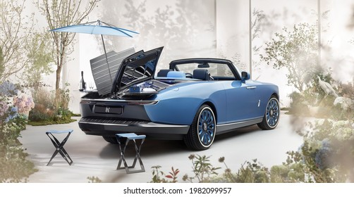 Shanghai, China - May 28, 2021: A blue  Tailor made Rolls-Royce Boat Tail limousine is parked in Greenhouse