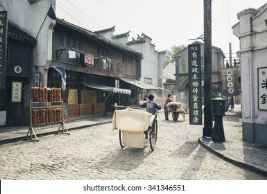 SHANGHAI, CHINA - MAY 6,2015: Chinses actors with props making movie in the recreated old shanghai street setup, film set, in Shanghai Film Park.