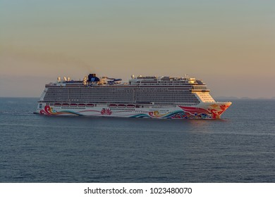 """SHANGHAI, CHINA - Nov 01, 2017: The world's fourth-biggest German-built luxury cruise liner """"Norwegian Joy"""" by NCL styled exclusively for Chinese travelers sails at sunset near Shanghai."""