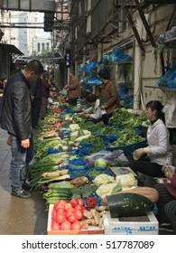 SHANGHAI, CHINA - NOV 18, 2016: Farmer's Marker on the back street of Shanghai selling fruits and vegetables .