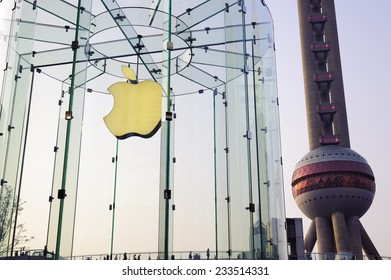 Shanghai, China - Nov 20, 2014: Apple store and Oriental Pearl Tower in Lujiazui Financial District, Pudong Shanghai, China