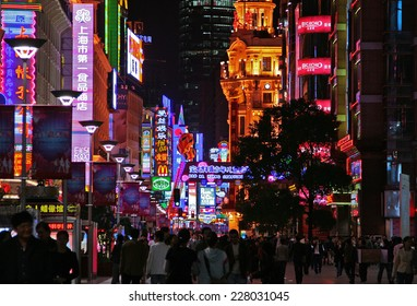 SHANGHAI, CHINA - NOV 3, 2007: Night view of Nanjing Road. Nanjing Lu is the main shopping street of the city, and is one of the world's busiest shopping streets